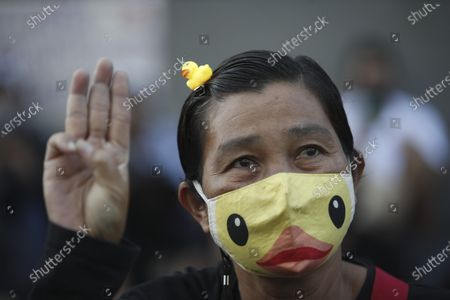 A Thai anti-government protester wearing a rubber-duck on her head flashes a three-finger salute during a street protest calling for political and monarchical reform in Bangkok, Thailand, 28 November 2020. Thailand has been facing political turmoil amid months-long street protests calling for the political and monarchical reform and the resignation of the prime minister Prayuth Chan-ocha.