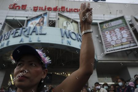 A Thai anti-government protester flashes a three-finger salute during a street protest calling for political and monarchical reform in Bangkok, Thailand, 28 November 2020. Thailand has been facing political turmoil amid months-long street protests calling for the political and monarchical reform and the resignation of the prime minister Prayuth Chan-ocha.