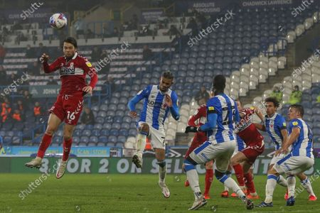 Jonathan Howson #16 of Middlesbrough wins a header from a corner during the game