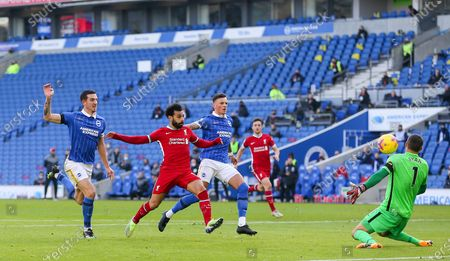 Liverpool forward Mohamed Salah (11) shoots at goal offside during the Premier League match between Brighton and Hove Albion and Liverpool at the American Express Community Stadium, Brighton and Hove