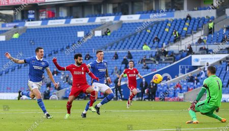 Liverpool forward Mohamed Salah (11) shoots past Brighton and Hove Albion goalkeeper Mathew Ryan (1) offside goal during the Premier League match between Brighton and Hove Albion and Liverpool at the American Express Community Stadium, Brighton and Hove