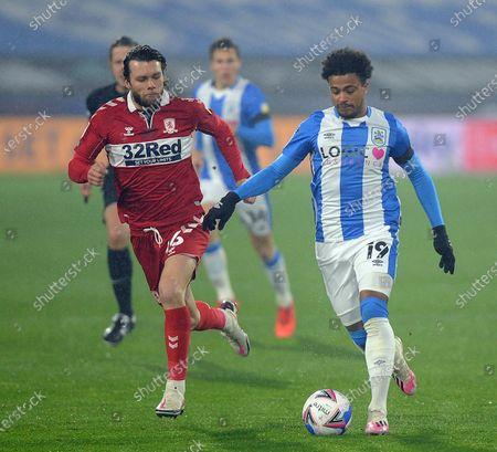 Huddersfield's Josh Koroma goes past Middlesbrough's Jonathan Howson