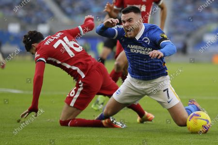 Brighton's Aaron Connolly, right, and Liverpool's Neco Williams vie for the ball during the English Premier League soccer match between Brighton and Hove Albion and Liverpool at the Amex stadium in Brighton, England