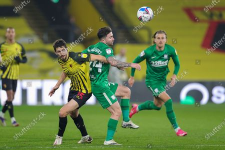 Stock Picture of Craig Cathcart (15) of Watford tussles with Sean Maguire (24) of Preston North End during the EFL Sky Bet Championship match between Watford and Preston North End at Vicarage Road, Watford