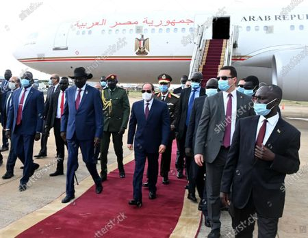 Editorial picture of Egypt's President Abdel Fattah al-Sisi and South Sudan's President Salva Kiir, wearing protective face masks, stand as they listen to national anthems, Juba, Sudan - 28 Nov 2020