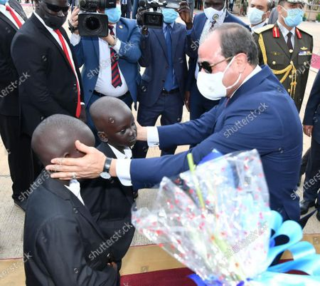 Stock Photo of Egypt's President Abdel Fattah al-Sisi and South Sudan's President Salva Kiir, wearing protective face masks, stand as they listen to national anthems in Juba, South Sudan, November 28, 2020. Photo by Egyptian President Office