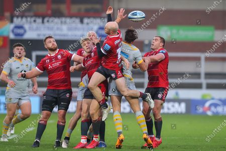Stock Photo of Joe Simpson of Gloucester Rugby and Josh Bassett of Wasps compete in the air