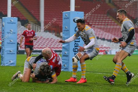 Stock Picture of Michael Le Bourgeois of Wasps touches down, despite the challenge of Joe Simpson of Gloucester Rugby