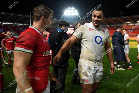 Leigh Halfpenny of Wales and Billy Vunipola of England at the end of the game.