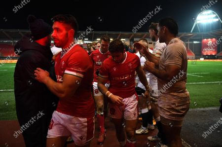 Rhys Webb and Leigh Halfpenny of Wales at the end of the game.