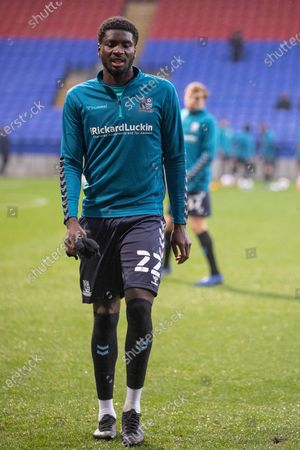 Southend United defender Richard Taylor (22) warming up before the  during the EFL Sky Bet League 2 match between Bolton Wanderers and Southend United at the University of  Bolton Stadium, Bolton