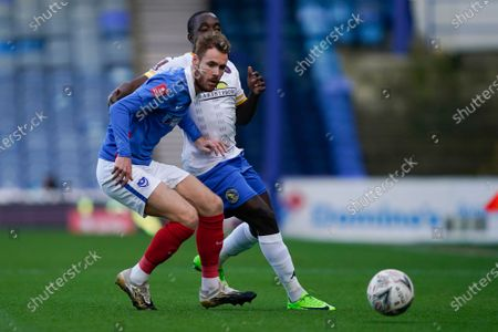 Tom Naylor of Portsmouth in action during the The FA Cup match between Portsmouth and Kings Lynn at Fratton Park, Portsmouth