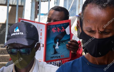 Ethiopians read publications covering the Tigray crisis at a Saturday news stand in Addis Ababa, Ethiopia 28 November 2020. Life continues as normal in the capital after the prime minister of Ethiopia Abiy Ahmed ordered the army to move on the embattled Tigray regional capital of Mekelle in the north of Ethiopia when a 72 hour ultimatum to surrender expired 26 November 2020. Ethiopia's military intervention comes after Tigray People's Liberation Front (TPLF) forces allegedly attacked an army base on 03 November 2020 sparking three weeks of unrest.