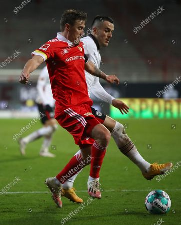 Max Kruse (L) of Union Berlin in action against Filip Kostic (R) of Eintracht Frankfurt during the German Bundesliga soccer match between FC Union Berlin and Eintracht Frankfurt in Berlin, Germany, 28 November 2020.