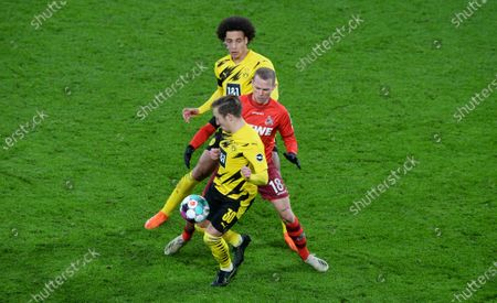 Dortmund's German defender Felix Passlack, Cologne's Slovakian midfielder Ondrej Duda and Dortmund's Belgian midfielder Axel Witsel vie for the ball during the German first division Bundesliga football match Borussia Dortmund v 1.FC Cologne at the Signal Iduna Park Stadium in Dortmund, Germany, 28 November 2020.