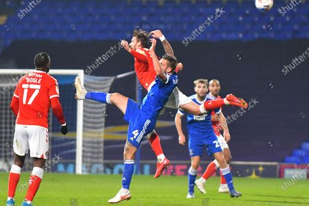 Charlton Athletic defender Jason Pearce (6) Ipswich Town defender Luke Chambers (4)  battles for possession during the EFL Sky Bet League 1 match between Ipswich Town and Charlton Athletic at Portman Road, Ipswich