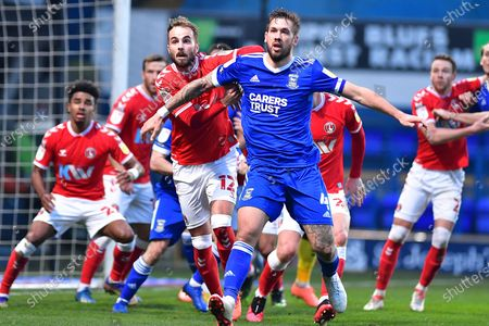 Charlton Athletic midfielder Andrew Shinnie (12) Ipswich Town defender Luke Chambers (4)  during the EFL Sky Bet League 1 match between Ipswich Town and Charlton Athletic at Portman Road, Ipswich