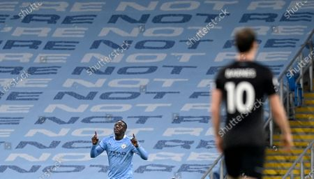 Manchester City's Benjamin Mendy, left, celebrates after scoring his side's third goal during the English Premier League soccer match between Manchester City and Burnley at the Etihad stadium in Manchester, England