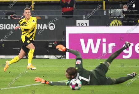 Dortmund's Thorgan Hazard (L) scores the 1-2 goal during the German Bundesliga soccer match between Borussia Dortmund and 1. FC Koeln in Dortmund, Germany, 28 November 2020.