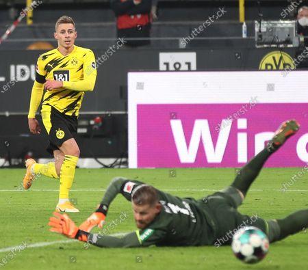 Stock Image of Dortmund's Thorgan Hazard (L) scores the 1-2 goal during the German Bundesliga soccer match between Borussia Dortmund and 1. FC Koeln in Dortmund, Germany, 28 November 2020.