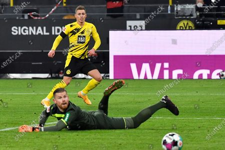 Stock Picture of Dortmund's Thorgan Hazard scores his side's opening goal during the German Bundesliga soccer match between Borussia Dortmund and 1.FC Cologne in Dortmund, Germany