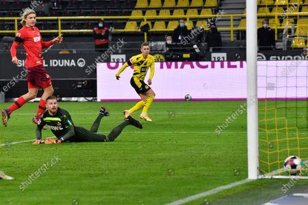 Dortmund's Thorgan Hazard scores his side's opening goal during the German Bundesliga soccer match between Borussia Dortmund and 1.FC Cologne in Dortmund, Germany