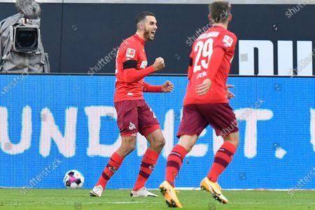 Cologne's Ellyes Skhiri, left, celebrates after scoring his side's opening goal during the German Bundesliga soccer match between Borussia Dortmund and 1.FC Cologne in Dortmund, Germany