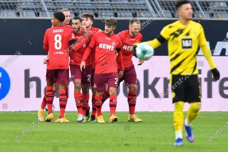 Cologne's Ellyes Skhiri, center left, celebrates after scoring his side's opening goal during the German Bundesliga soccer match between Borussia Dortmund and 1.FC Cologne in Dortmund, Germany