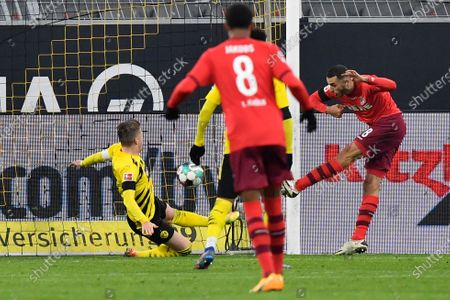Cologne's Ellyes Skhiri scores his side's second goal during the German Bundesliga soccer match between Borussia Dortmund and 1.FC Cologne in Dortmund, Germany