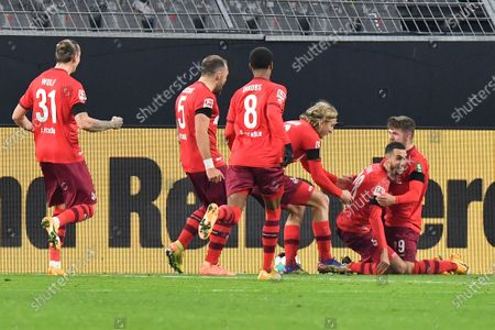 Cologne's Ellyes Skhiri, second right, celebrates after scoring his side's second goal during the German Bundesliga soccer match between Borussia Dortmund and 1.FC Cologne in Dortmund, Germany