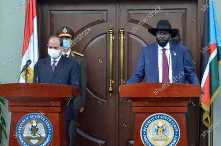 Egypt's President Abdel-Fattah el-Sissi, left, and South Sudan's President Salva Kiir, right, make a statement to the media after meeting at the president's office in the capital Juba, South Sudan . The Egyptian president is on a one-day visit to discuss bilateral relations