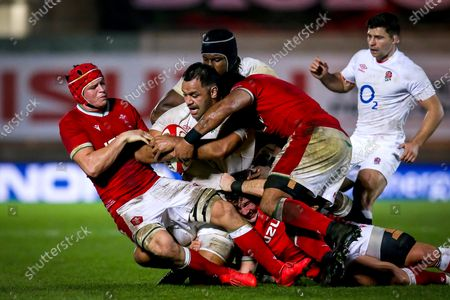 Wales vs England. England's Billy Vunipola is tackled