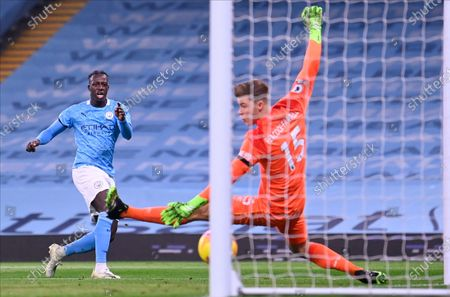 Stock Photo of Manchester City's Benjamin Mendy (L) scores against Burnley's goalkeeper Bailey Peacock-Farrell (R) during the English Premier League soccer match between Manchester City and Burnley FC in Manchester, Britain, 28 November 2020.