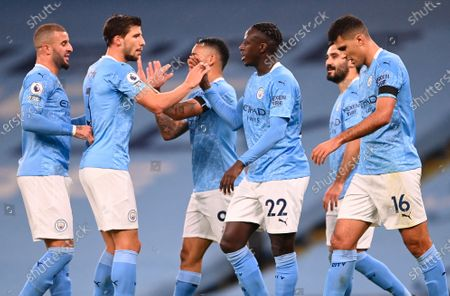 Manchester City's Benjamin Mendy (center R) celebrates with teammates after scoring against Burnley during the English Premier League soccer match between Manchester City and Burnley FC in Manchester, Britain, 28 November 2020.