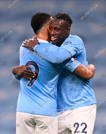 Manchester City's Benjamin Mendy ( R) celebrates with Manchester City's Gabriel Jesus (L) after scoring against Burnley during the English Premier League soccer match between Manchester City and Burnley FC in Manchester, Britain, 28 November 2020.