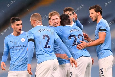 Manchester City's Benjamin Mendy (center R, with back) celebrates with teammates as being comforted by Kevin De Bruyne (C) after scoring against Burnley during the English Premier League soccer match between Manchester City and Burnley FC in Manchester, Britain, 28 November 2020.