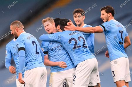Stock Image of Manchester City's Benjamin Mendy (center-with back) celebrates with teammates as being comforted by Kevin De Bruyne (center -L) after scoring against Burnley during the English Premier League soccer match between Manchester City and Burnley FC in Manchester, Britain, 28 November 2020.