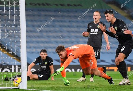 Stock Picture of Burnley's goalkeeper Bailey Peacock-Farrell (C) stretches for a tricky ball during the English Premier League soccer match between Manchester City and Burnley FC in Manchester, Britain, 28 November 2020.