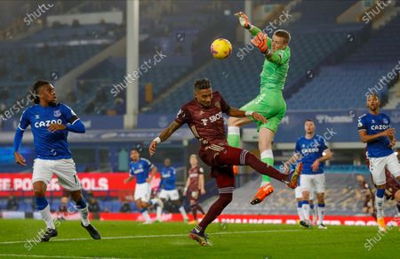 Leeds United forward Raphinha (18) and Everton goalkeeper Jordan Pickford (1)  during the Premier League match between Everton and Leeds United at Goodison Park, Liverpool