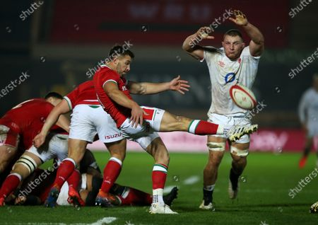 Stock Picture of Rhys Webb of Wales is challenged by Sam Underhill of England.