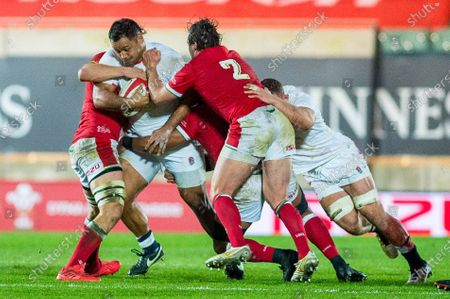 Billy Vunipola of England is tackled