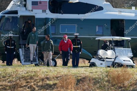 President Donald Trump, Donald Trump Jr., Eric Trump and Kimberly Guilfoyle get off Marine One after it landed at Trump National Golf Club, in Sterling, Va