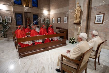 Pope Francis with Pope Emeritus Benedict XVI as he pays him a visit after the Consistory, with the newly elevated Cardinals, at the Vatican