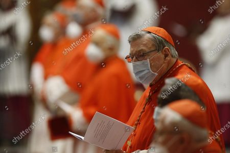 Cardinal George Pell attends a consistory ceremony where 13 bishops were elevated to a cardinal's rank in St. Peter's Basilica at the Vatican