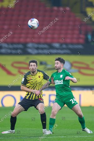 Craig Cathcart of Watford and Sean Maguire of Preston North End battle for possesion