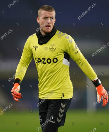 Stock Photo of Everton's goalkeeper Jordan Pickford takes part in the warm up ahead of the English Premier League soccer match between Everton and Leeds United, at Goodison Park in Liverpool, England