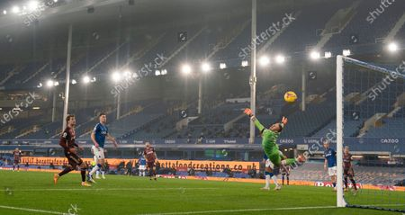 Everton's goalkeeper Jordan Pickford makes a flying save from Leeds United's Raphinha during the English Premier League soccer match between Everton and Leeds United, at Goodison Park in Liverpool, England