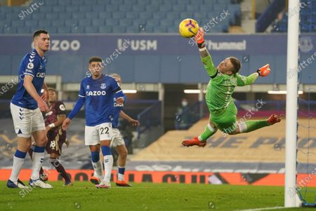 Stock Image of Everton's goalkeeper Jordan Pickford makes a flying save from Leeds United's Raphinha during the English Premier League soccer match between Everton and Leeds United, at Goodison Park in Liverpool, England
