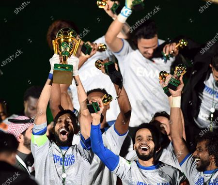 Al-Hilal's captain Salman Al-Faraj (L) lifts the cup as Al-Hilal's players celebrate after winning the Saudi King's Cup final soccer match between Al-Hilal and Al-Nassr at King Fahd International Stadium, in Riyadh, Saudi Arabia, 28 November 2020.