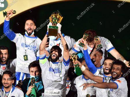Al-Hilal's captain Salman Al-Faraj (C) lifts the cup as Al-Hilal's players celebrate after winning the Saudi King's Cup final soccer match between Al-Hilal and Al-Nassr at King Fahd International Stadium, in Riyadh, Saudi Arabia, 28 November 2020.